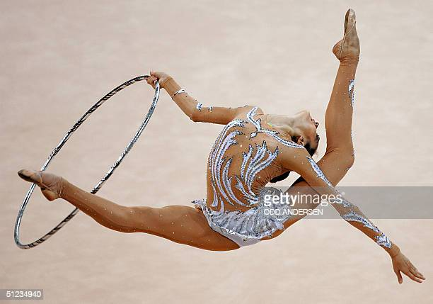 Olympic bronze medalist Anna Bessonova of Ukraine performs with the hoop during the individual allround final of the gymnastics rythmic at the...