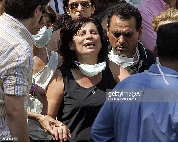 One of the relatives of a victim of the Cypriot private lines Helios' plane which crashed down 14 August near Athens mourns after recognizing the...