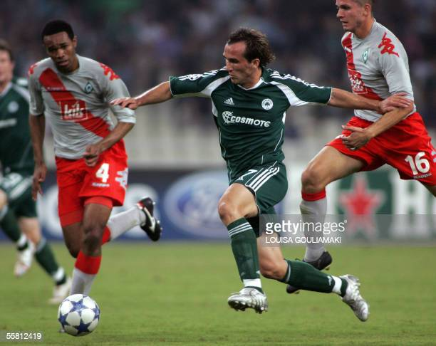 Panathinaikos Athens Theofanis Gekas tries to score past Werder Bremen's Naldo during their Champions League match group C at the Olympic Stadium in...