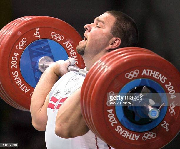 Poland's Grzegorz Kleszcz competes during the men's 105 kg weightlifting competition at Nikaia Olympic Weightlifting Hall in Athens City 25 August...