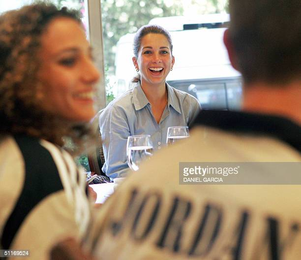 Princess Haya from Jordan, daughter of former King Hussein and half-sister of King Abdullah chats with Jordanian swimmers Jordanian swimmers Samar...