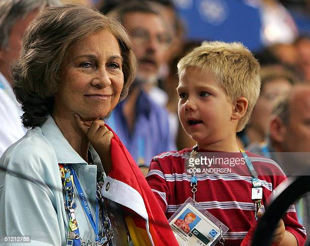 Queen Sofia of Spain is tickled by her grandson Juan while watching Spain play Germany in the men's handball quarterfinal clash at the Athens 2004...