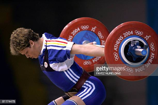 Romania's Marioara Munteanu competes during the women's 53 kg weighlifting competition of the Olympic games at Nikaia Olympic Weighlifting Hall in...