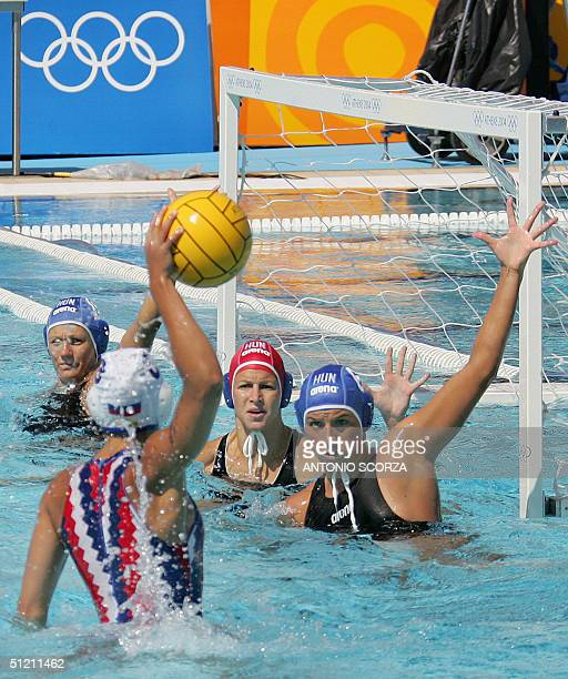 Russian water polo player Svetlana Bogdanova tries to take a shot as Hungarian players block the goal during their match for fifith place in the 2004...