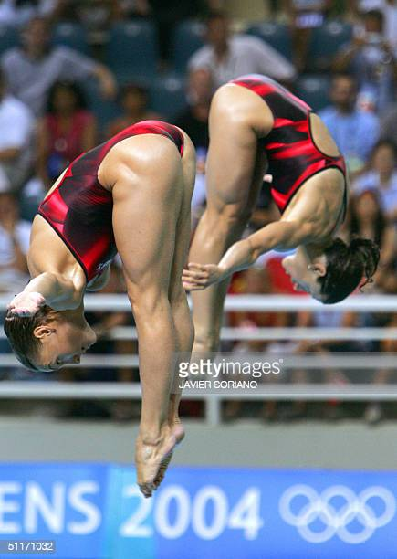 Russian Yulia Pakhalina and Vera Ilyina perform en route to the silver medal during the women's 3 meters springboard synchronised final in Athens 14...