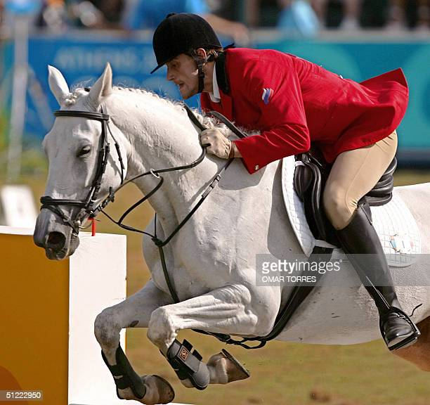 Russia's Andrey Moiseev and his horse 'Osiride di Acciarella' clears one of the obstacles during the riding discipline of the modern pentathlon 26...