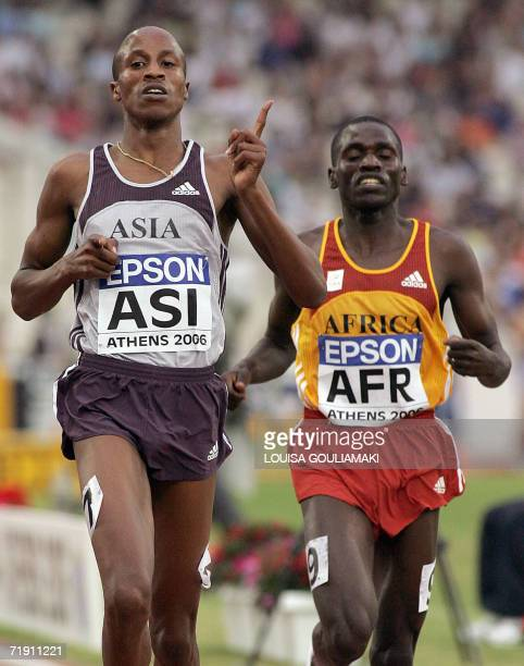 Saif Saaeed Shaheen of Qatar wins the 3000m steeplechase race ahead of Kenyan Paul Koech during the Athletics World Cup Athens 2006, at the Olympic...
