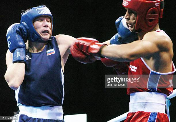 Saleh Khoulef of Egypt and Alexander Maletin of Russia exchange blows during their 64 kg Light Welterweight preliminary Olympics match at the...