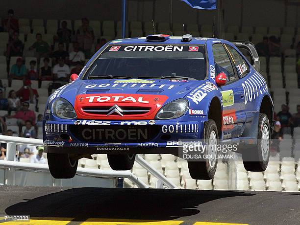 Sebastien Loeb of France with codrivel Daniel Elena of Monaco speed up their Citroen Xsara at the last super special stage of the 53rd Rally...
