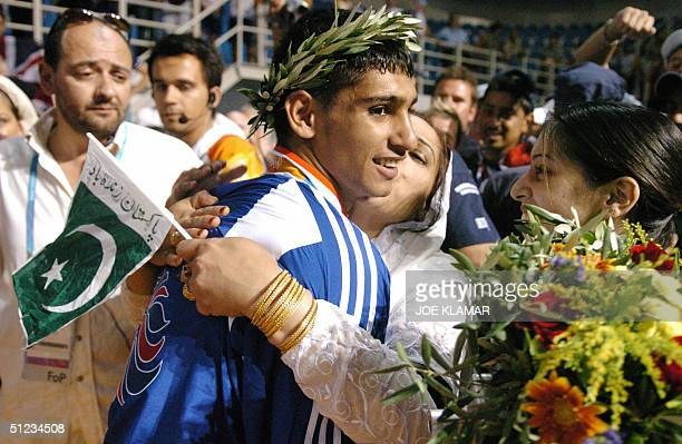 Silver medalist Amir Khan of Great Britain is greeted during the Olympic Games awards ceremony for the lighweight boxing competition 29 August 2004...