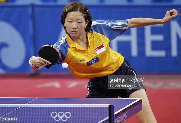 Singapore's Li Jia Wei hits a return in her women's singles semifinal table tennis match against Kim HyangMi of North Korea at the Olympic Games 21...