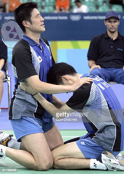South Korea's Kim Dongmoon joins his partner Ha Taekwon in prayers after beating teammates Lee Dongsoo and Yoo Yongsung in the men's double final of...
