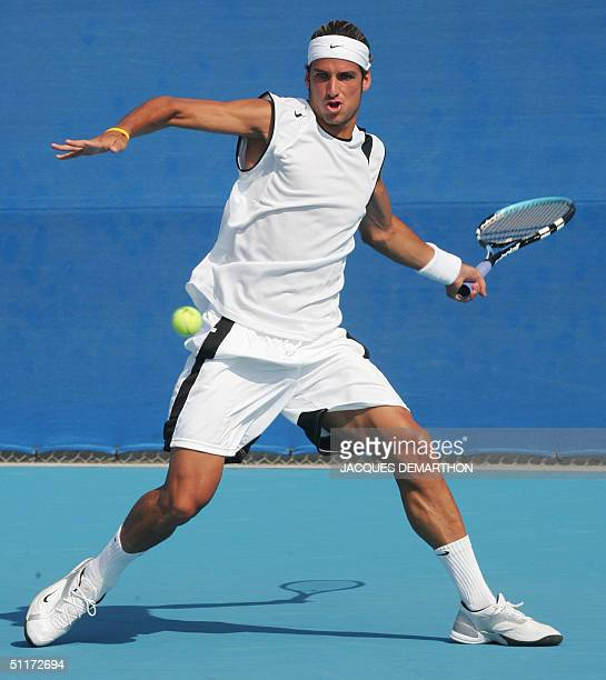 Spain's Feliciano Lopez prepares a forehand to Sweden's Robin Soderling 15 August 2004 in Athens during their first round match at the 2004 Olympic...