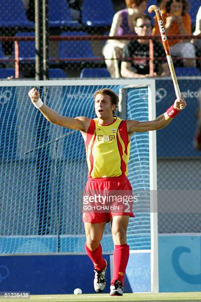 Spain's Santiago Freixa jubilates after scoring a penalty flick goal against Germany in the bronze medal match of the men's hockey competition in the...