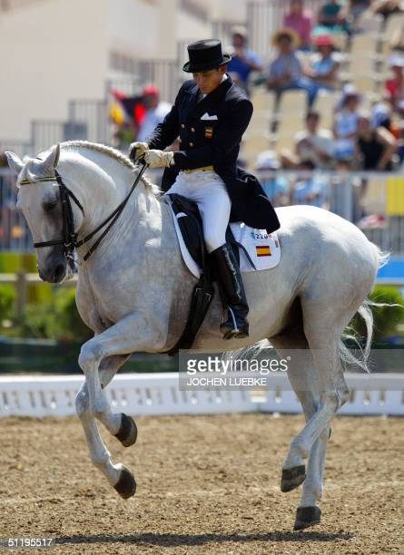"Spanish dressage rider Rafael Soto rides his horse ""Invasor"", 20 August 2004 at the Markopoulo Olympic Equestrian Centre in Athens during the 1st..."