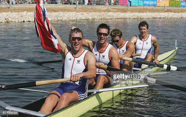 Steve Williams James Cracknell Ed Coode and Matthew Pinsent celebrate their win in the men's four rowing final 21 August 2004 during the Athens 2004...