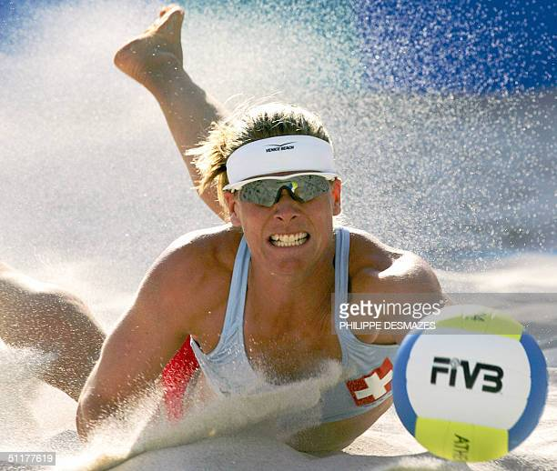 Swiss player Nicole Schnyder returns the ball during the Olympic Games second round women's beach volleyball match against Norway 16 August 2004 in...