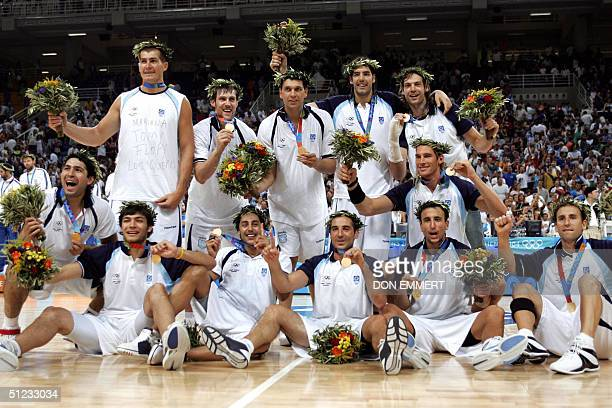 The Argentinian team show off their medals after their win in the Olympic Games men's basketball finals 28 August 2004 at the Olympic Indoor Hall in...