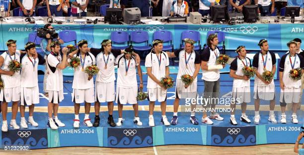 The Argentinian team stands on the podium after winning gold in the Olympic Games men's basketball gold medal match 28 August 2004 at the Olympic...