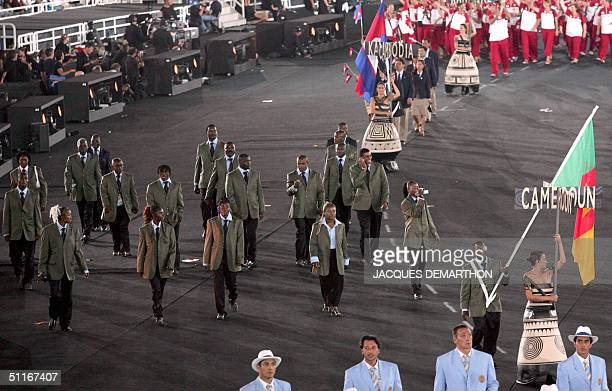 The Cameroon delegation parades during the opening ceremony of the 2004 Olympic Games 13 August 2004 at the Olympic Stadium in Athens Host Greece...