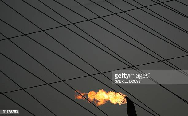 The Olympic flame burns above the main Olympic Stadium during the summer games in Athens 16 August 2004. AFP PHOTO/GABRIEL BOUYS