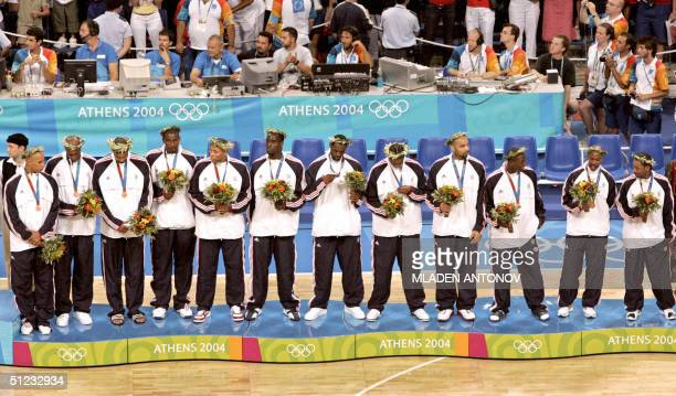 The US team stands on the podium after winning silver in the Olympic Games men's basketball gold medal match 28 August 2004 at the Olympic Indoor...
