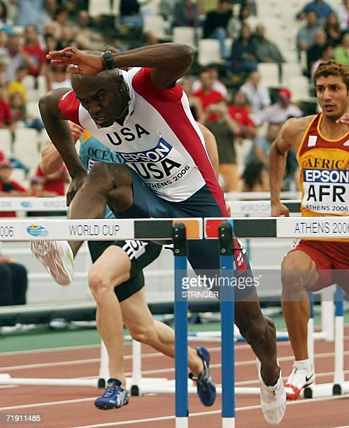 The winner at 110m hurdles race USA's Allen Johnson jumps a hurdle during the 10th IAAF World Cup at the Athens' Olympic stadium 17 September 2006...