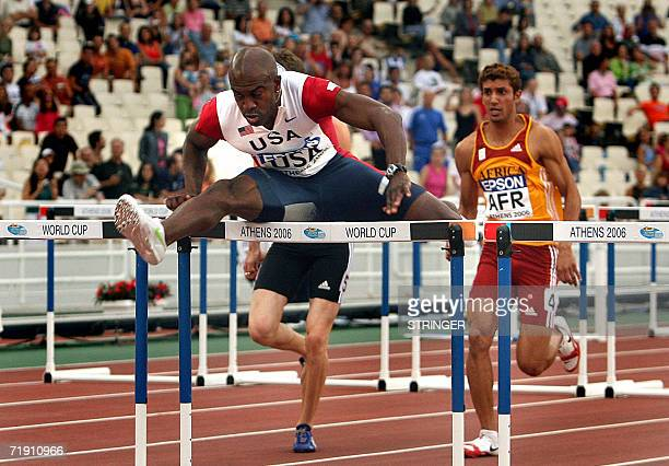 The winner of the 110m hurdles race US Allen Johnson jumps a hurdle during the 10th IAAF World Cup at the Athens' Olympic stadium 17 September 2006...