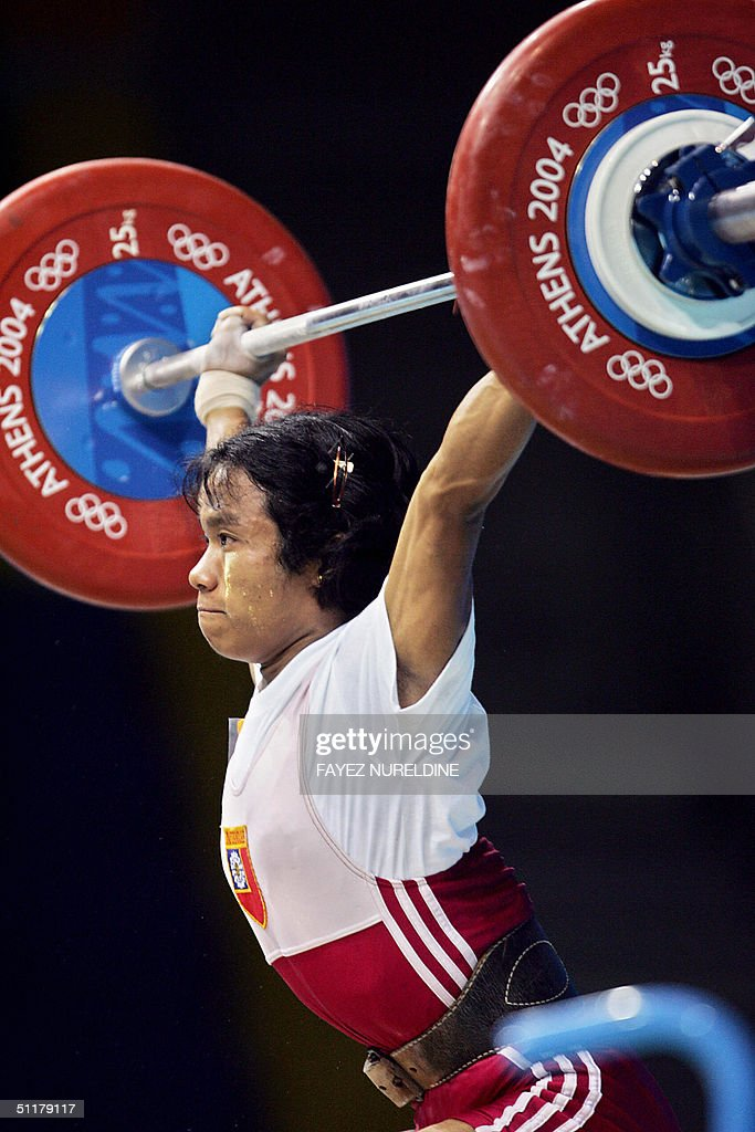 This 14 August 2004 file photo shows Nan Aye Khine of Myanmar competing in the -48 kg category of the Olympic Games women's weighlifting event in Athens. Nan Aye Khine has been thrown out of the Olympics after failing a drugs test, the International Olympic Committee announced 16 August 2004. Nan Aye Khine, who finished fourth in the women's 48kg division 14 August 2004, was found to have taken an anabolic steroid. AFP PHOTO / FILES / Fayez NURELDINE