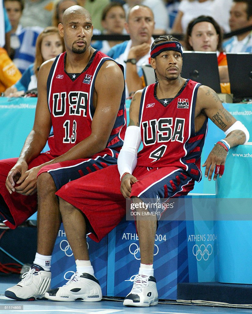 Tim Duncan (L) and Allen Iverson of the : News Photo