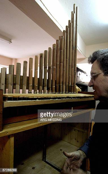TO GO WITH AFP STORY Instrumentmaker George Paraschos works on a reconstructed version of the hydraulis an ancestor of the modern church organ...