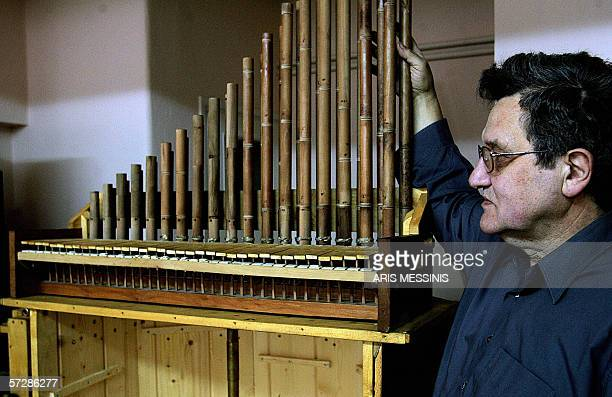 TO GO WITH AFP STORY Instrumentmaker George Paraschos stands next to a reconstructed version of the hydraulis an ancestor of the modern church organ...
