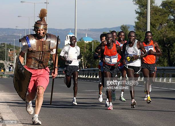 Tom Podesta from the US dressed as an ancient Greek warrior runs next to leading group with the Kenyan winner of the Athens Classic Marathon Henry...