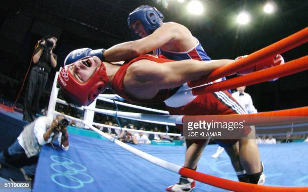 Trevor Stewardson of Canada is worked against the ropes by Ahmed Ismail of Egypt during their Olympic Games second round Light Heavyweight match 19...