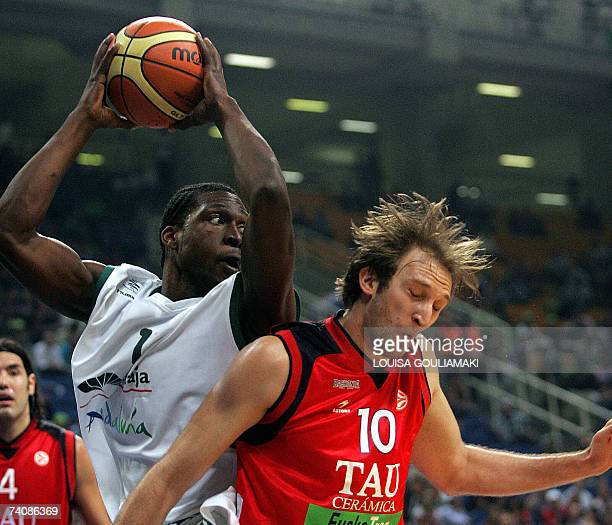 Unicaja's Malaga Marcus Brown tries to score past Tau Ceramica Zoran Planicic during their Euroleague basketball Final Four match for the third place...