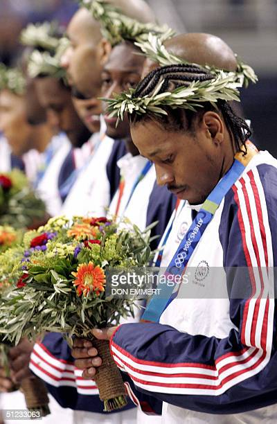 USA's Allen Iverson stand on the podium with team mates during their Bronze medals ceremony following the Olympic Games men's basketball finals 28...