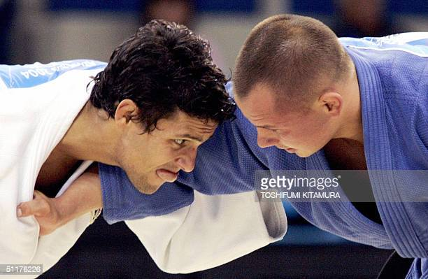 Victor Bivol of Moldova fights with Joao Neto of Portugal during their quarterfinal round of men's under 73kgs event of Judo competition in the 2004...
