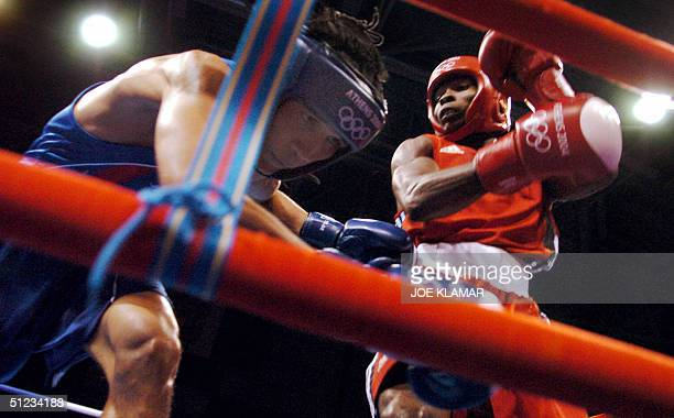 Worapoj Petchkoom of Thailand defends against Guillermo Rigondeayx Ortiz of Cuba during their bantamweight boxing final of the Olympic Games 29...