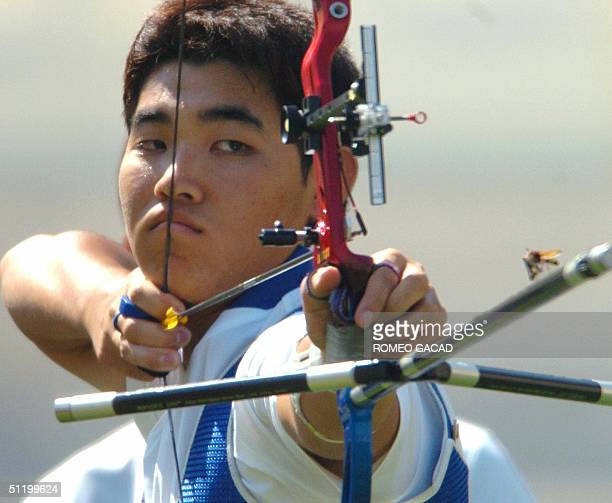 World number one archer Im Dong Hyun from team South Korea eyes a flying insect resting on the stabilizer of his bow moments before shooting his...