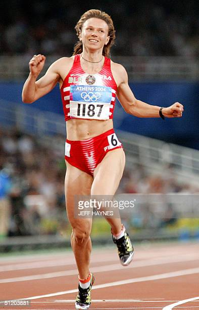 Yuliya Nesterenko of Belarus competes in the women's 100m finals 21 August 2004 during the Olympic Games athletics competitions at the Olympic...