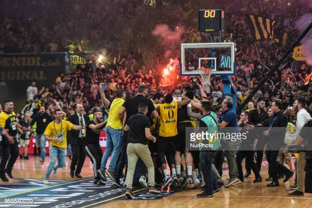 AEK Athens players and supporters celebrate after winning the Final Four Champions League basketball final game between AS Monaco and AEK Athens at...