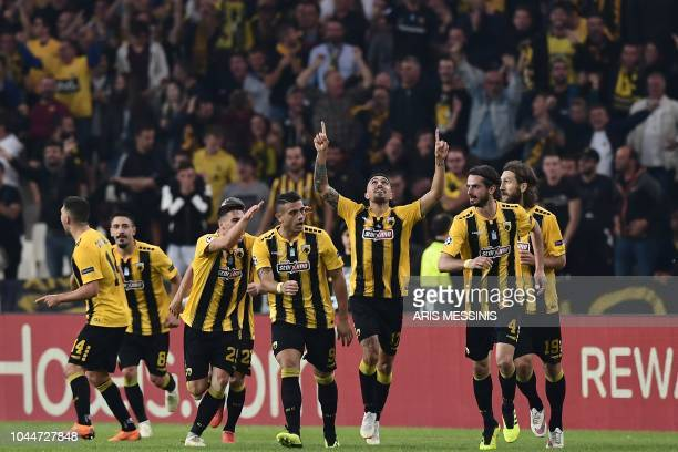AEK Athens' players celebrate after scoring a goal during the UEFA Champions League football match AEK Athens vs Benfica Lisbon at the Olympic...