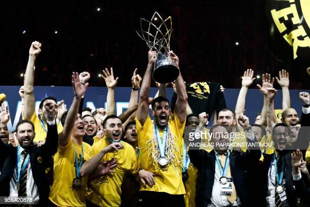 AEK Athens' players celebrate with the trophy after winning the Final Four Champions League basketball final game between AS Monaco and AEK Athens at...