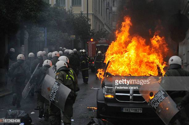 Athens rioter burning car during the general strike of December 15 2010