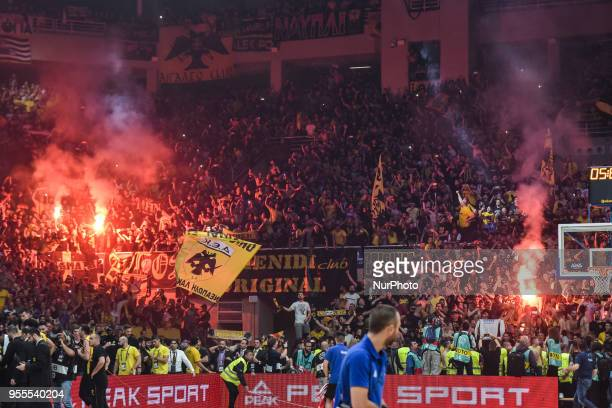 AEK Athens supporters celebrate after winning the Final Four Champions League basketball final game between AS Monaco and AEK Athens at the OAKA...