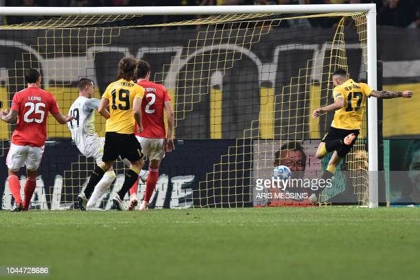 AEK Athens' Victor Klonaridis scores a goal during the UEFA Champions League football match AEK Athens vs Benfica Lisbon at the Olympic stadium in...