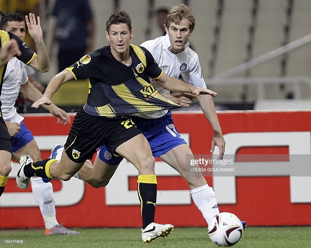 AEK Athens's Nathan Burns (L) challenges HNK Hajduk Split's Irvin Strinic during their UEFA Europa League football match at the Olympic stadium in Athens on September 16, 2010.