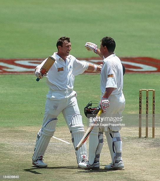 Atherton reaches his 100 Robin Smith congratulates him South Africa v England 2nd Test Johannesburg Nov 95