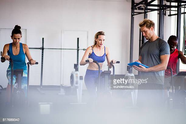 Athetic friends on indoor cycling during a fitness training class