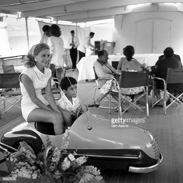 Athina Livanos first wife of shipping magnate Aristotle Socrates Onassis on board Aristotle's yacht 'Christina' with her son Alexander in Monte Carlo